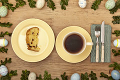Easter decoration, coffee cup,plate with cake on wood Royalty Free Stock Image