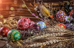 Free Easter Decoration. Colored Easter Eggs And Composition Of Dried Stock Photos - 109680763