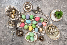 Easter decoration colored eggs and birds feather Royalty Free Stock Images