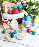 Easter decoration with colored eggs and Easter cakes Stock Images