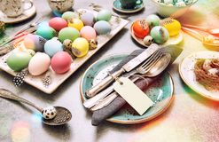 Easter decoration colorful eggs green plants vintage toned Stock Images