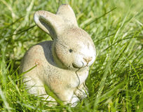 Easter Decoration. Cute Easter Bunny as decoration in tall grass Royalty Free Stock Photos