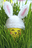 Easter decoration with cute egg in bunny hat Stock Photo