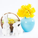 Easter decoration with daffodils, rabbits and eggs Stock Photos