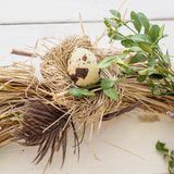 Easter decoration with a egg. Easter decoration with a rabbit and eggs on a wreath royalty free stock photo