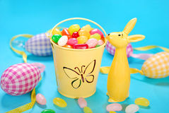 Easter decoration with egg shaped candies in bucket and rabbit f Royalty Free Stock Images