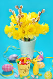 Easter decoration with egg shaped candies in bucket and rabbit f Royalty Free Stock Photo