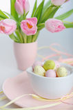 Easter decoration with eggs and beautiful pink tulips Royalty Free Stock Photos