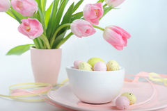Easter decoration with eggs and beautiful pink tulips Stock Photos