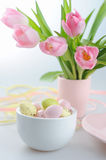 Easter decoration with eggs and beautiful pink tulips Stock Images