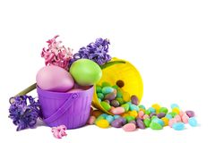 Easter decoration eggs and candy in basket on white background, copy space royalty free stock photo