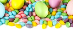 Easter decoration eggs and candy on white background. Easter background royalty free stock images