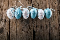 Easter decoration eggs cute bunny. Happy Easter. Vintage style t. Oned picture Text in GErman HAPPY ESTER royalty free stock photography