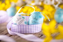 Easter decoration eggs cute bunny. Happy Easter. Vintage style t. Oned picture Text in GErman HAPPY ESTER stock images