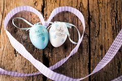 Easter decoration eggs cute bunny. Happy Easter. Vintage style t. Oned picture Text in GErman HAPPY ESTER stock photos