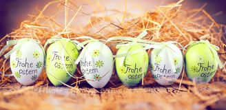Easter decoration eggs cute bunny. Happy Easter. Vintage style t. Oned picture Text in GErman HAPPY ESTER royalty free stock images