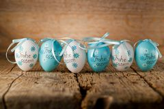Easter decoration eggs cute bunny. Happy Easter. Vintage style t. Oned picture Text in GErman HAPPY ESTER royalty free stock photo