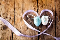 Easter decoration eggs cute bunny. Happy Easter. Vintage style t. Oned picture Text in GErman HAPPY ESTER stock photo