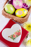 Easter decoration with eggs, flowers and heart Stock Photos