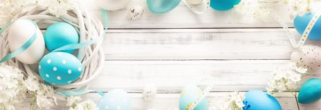 Easter Decoration with Eggs and Flowers. On White Wooden Background Royalty Free Stock Photo