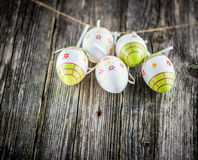 Easter decoration eggs. Hanging on grey old wooden background Stock Image