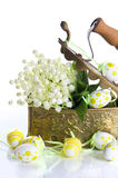 Easter decoration with eggs and lily flowers Royalty Free Stock Photography