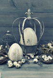 Easter decoration with eggs, nest and birdcage Royalty Free Stock Photos