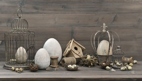 Easter decoration with eggs, nest and vintage birdcage Stock Images