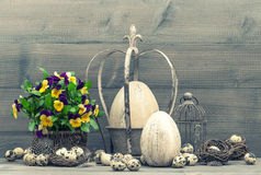 Easter decoration with eggs and pansy flowers Royalty Free Stock Photography