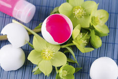 Easter decoration with eggs and red tempera paint on a blue pad. Easter decoration with egg shells  and red tempera paint on a blue pad Stock Image