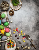 Easter decoration with eggs and sweets. Dark toned Royalty Free Stock Photography