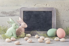 Easter decoration. Empty blackboard and easter decoration royalty free stock image