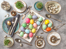 Easter decoration. Festive table setting colored eggs Royalty Free Stock Image