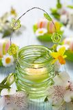 Easter decoration with flowers, candles and eggs Stock Photo