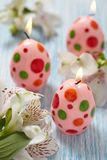 Easter decoration with flowers, candles and eggs Royalty Free Stock Photography