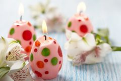 Easter decoration with flowers, candles and eggs Royalty Free Stock Photos