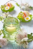 Easter decoration with flowers, candles and eggs Royalty Free Stock Images