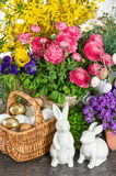 Easter decoration with flowers, eggs, bunnies and cake Royalty Free Stock Photos
