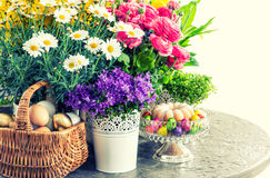 Easter decoration with flowers, eggs and cake. Vintage style Stock Images