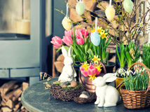 Easter decoration with flowers and eggs. Tulips and narcissus Stock Photo