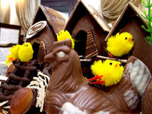 Easter decoration in form of chocolate chicken houses royalty free stock photography