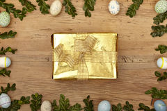 Easter decoration, golden present Stock Images