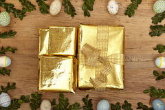 Easter decoration, golden presents Royalty Free Stock Image