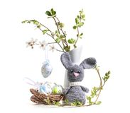 Easter decoration with  hare amigurumi. Easter decoration with flowering cherry and hare amigurumi Royalty Free Stock Photography