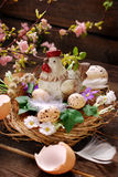 Easter decoration with hen in the nest and eggs Stock Photo