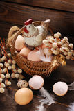 Easter decoration of hen in wicker basket with eggs Stock Images