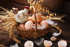 Easter decoration of hen in wicker basket with eggs Stock Image