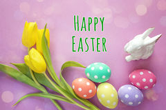 Easter decoration with message Happy Easter, spotted eggs, rabbi Royalty Free Stock Images