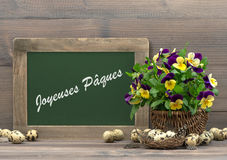 Easter decoration pansy flowers and blackboard Stock Photos