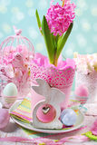 Easter decoration with pink hyacinth in pot and wooden rabbit Royalty Free Stock Photo